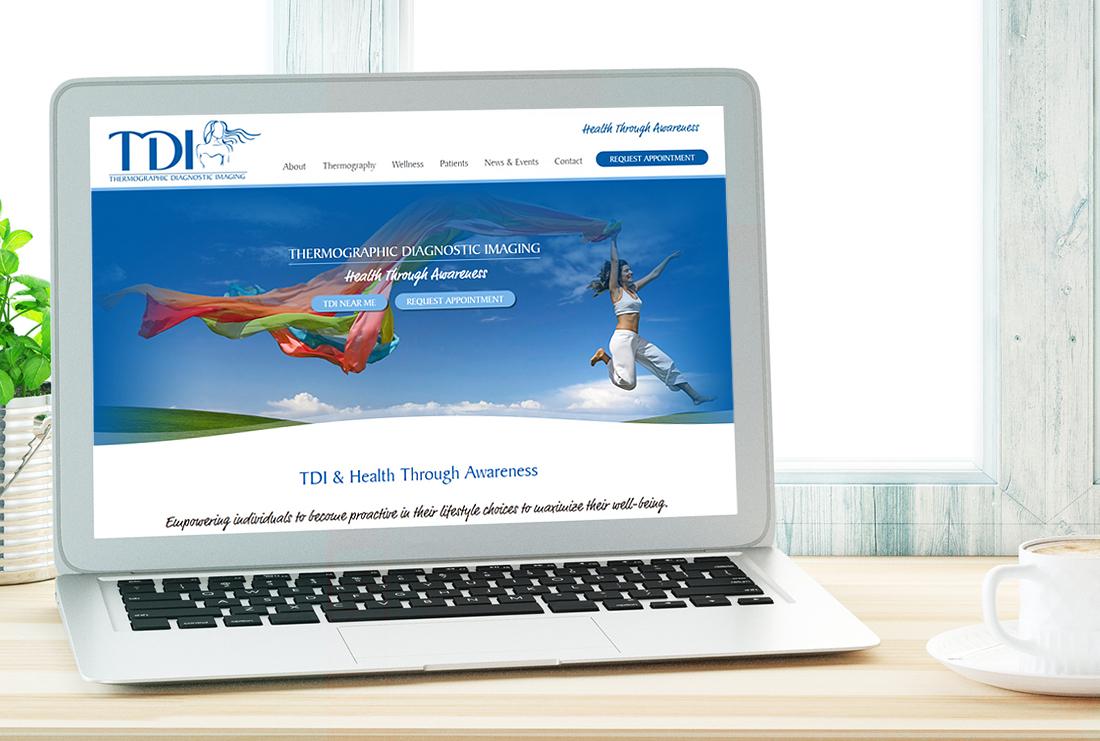 TDI & Health Through Awareness Website shown on laptop